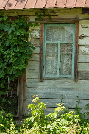 Old wooden window in wooden house in village photo