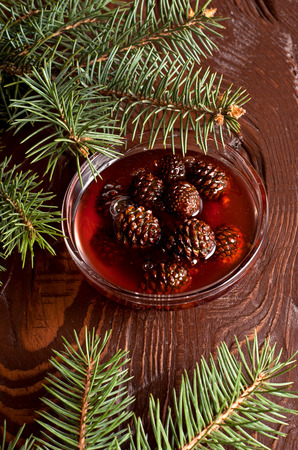 confiture: The Confiture from fir cones in dish on wooden table