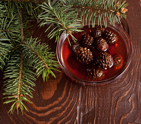 fir cones: The Jam from fir cones in dish on wooden table