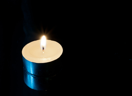candle wick: One Candle on black background and reflection Stock Photo