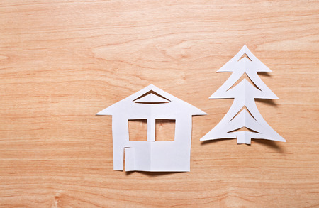 christmas house: Christmas concept: Paper house and christmas tree on the wooden