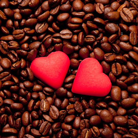 cofe: two red hearts on coffee beans, love concept