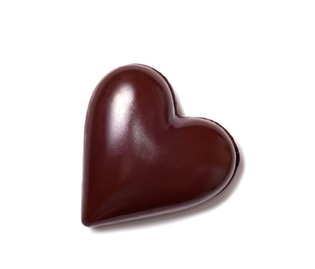 black heart: big chocolate heart and red riibbon on white background