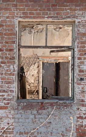 catastrophe: A Window in Destroyed building. Concept demolition, war, earthquake, catastrophe, disaster