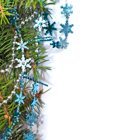 Christmas fir and blue decoration on white background, space for your text. Christmas postcard Stock Photo