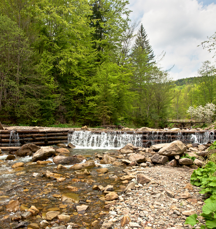 Panorama of the dam across a mountain river. Carpathians mountains in Ukraine Stock Photo