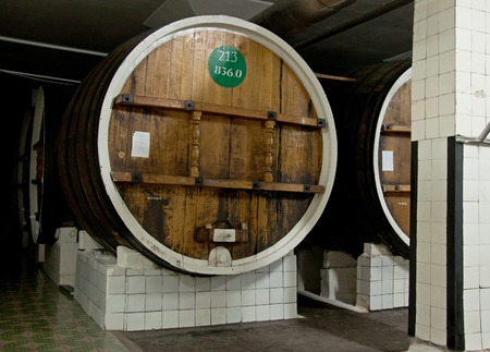YALTA, CRIMEA - MAY 04, 2013: Wines in big wooden barrels in the Massandra winery, Yalta, Crimea, Ukraine on May 04, 2013. Collection wines in Massandra winery is one of the largest collections of rare wines in the world