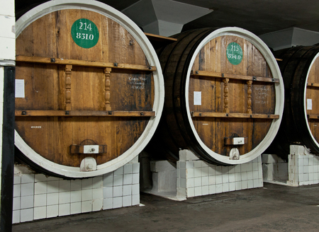 YALTA, CRIMEA - MAY 04, 2013: Wines in big wooden barrels in Massandra winery, Yalta, Crimea, Ukraine on May 04, 2013. Collection wines in Massandra winery is one of the largest collections of rare wines in the world