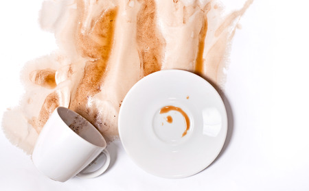 White Coffee cup spill on white background. Creative coffee art background