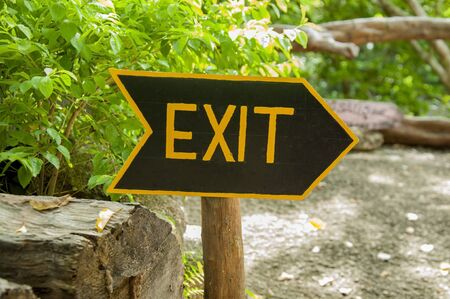way out: The sign of the exit is written in yellow ink on a black background, set in the park Stock Photo