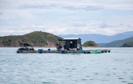 Marine fish farm in Vietnam. Floating houses. Stock Photo
