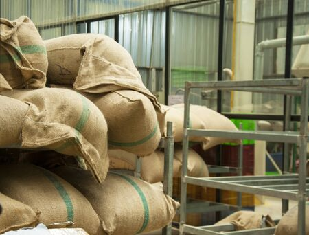 maize flour: Bags in the warehouse on the racks. Coffee, arabica, rice.