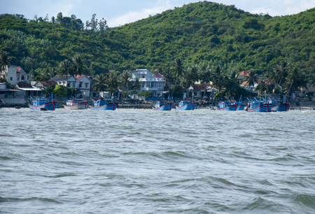 Marine fish farm in Vietnam. Floating houses. Stock Photo