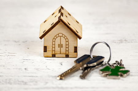 The little house next to it is the keys. Symbol of hiring a house for rent, selling a home, buying a home, a mortgage