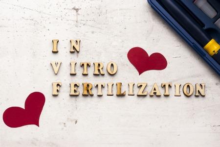 In Vitro Fertilization Injection Pen. Syringe with a thin ogre. Concept IVF Treatment Drugs Medication Infertility. Acronym (abbreviation) IVF. Stock Photo - 117556132