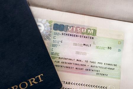Two travelers passports with a Schengen visa. Euro-trip. Selective focus