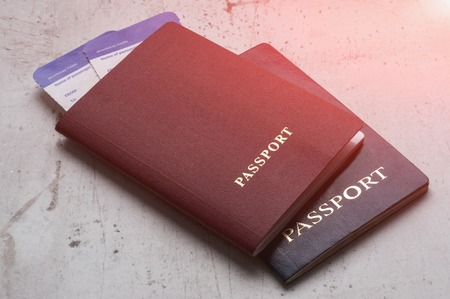 Two travelers passports red and blue with boarding passes for the plane. Travel concept Selective focus Banque d'images