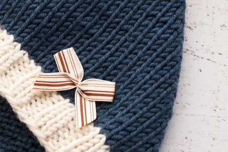 Children's woolen knitted hats on a light background. Child care concept. DIY.