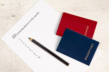 Blue and red travel passports on a light background, next to the inscription ten amazing places in the world