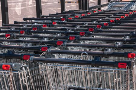 Shopping carts in the store, assembled in a row in the parking lot. Close-up