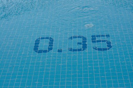 A full pool with a depth symbol on the tile below the surface of the water. Depth thirty-five centimeters