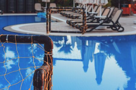 Water polo gate near a full pool. Water sports. Active leisure Stok Fotoğraf