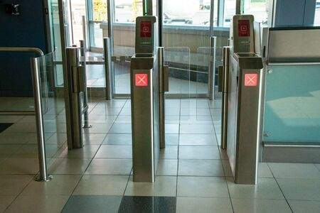 An exit counter to airplanes at the airport. Closed, red signal. Airport equipment. Organization of passenger traffic at the airport. Checkpoint at the airport