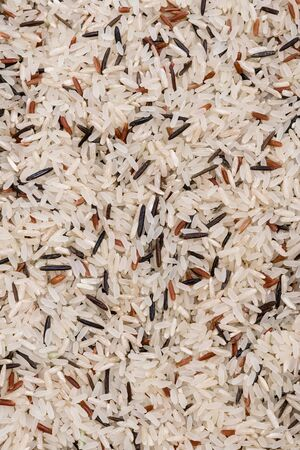 White and black raw rice close-up. Cereals, cooking
