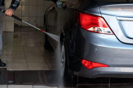 Gray car wash with water at a car wash. Contactless sink. Car wash. Self-service car wash 스톡 콘텐츠
