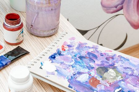 Tools of the artist. Palette, paints, brushes during use. Creativity and painting. Stock fotó