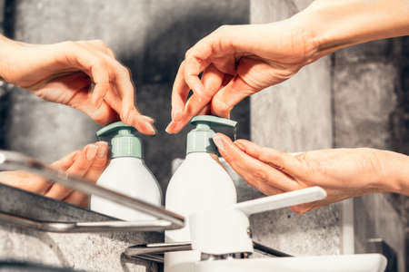 Coronavirus. Proper washing and handling of hands. Jar of liquid anti-bacterial soap. Self-isolation and hygiene