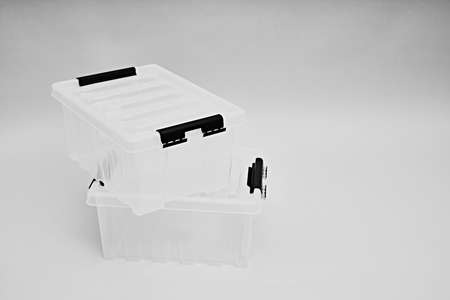 Transparent plastic box for storage and transportation. Boxes for the delivery of products. Orderly storage