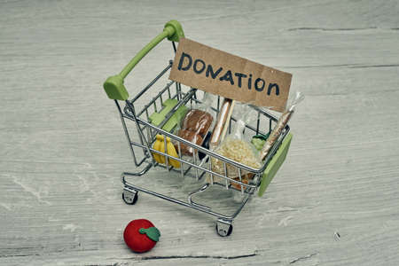 Donations food. Help products during a pandemic, charity. Cart with products.