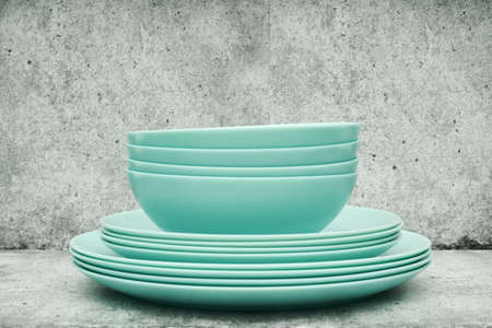 A stack of dishes on a light background. Glass set of dishes for the kitchen. close up