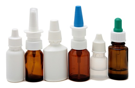 nasal drops: Bottles with drops and spray nasal drops isolated on white