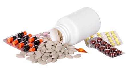 various medicines, pills and syringes on a white with the reflection. photo