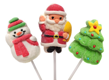 Three Christmas and new year sweets . Christmas tree, Santa Claus and Snowman. Isolated on white . photo