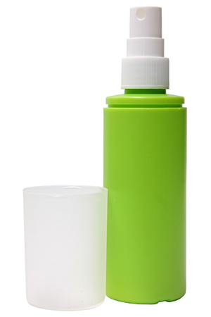 sud: Green plastic bottle of spray isolated on a white .
