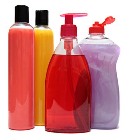 productos quimicos: cuatro botellas de plástico de colores con jabón líquido y gel de ducha