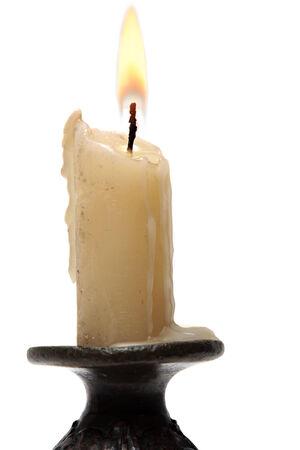 llamas de fuego: vela viejo aislado en blanco Foto de archivo