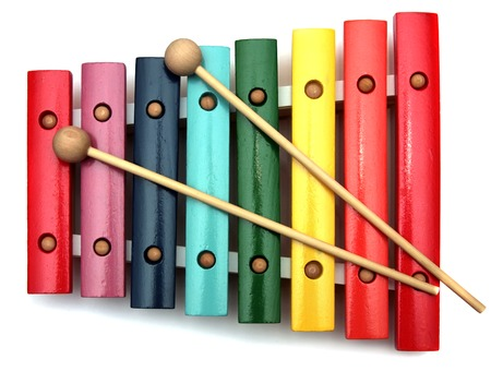 colorful, wooden xylophone with mallet over white