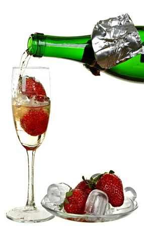 Bottle of champagne, wine, strawberry and ice isolated on a white background. photo