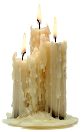 three beautiful old candle isolated on white background