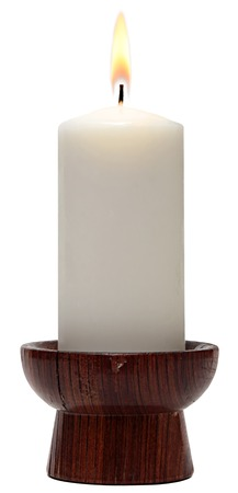 white candle: burning old candle vintage wooden candlestick. Isolated on a white background.