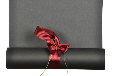 livid: piece of black  paper rolled up in a roll isolated on white background Stock Photo
