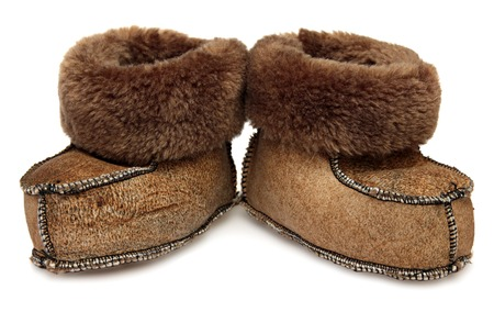Childrens shoes. Baby fur booties isolated on a white background. photo
