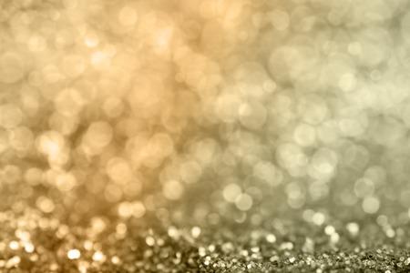 Goudklompjes sprankelende tapijt. Close-up uitzicht, zeer ondiepe diepte van het veld. Stockfoto