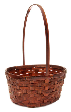 willow fruit basket: vintage weave wicker basket isolated on a white background