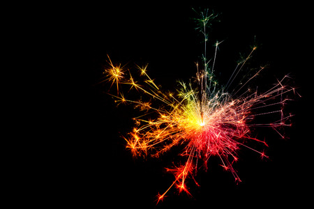 text space: Sparkler. Christmas and newyear party sparkler on black background Stock Photo