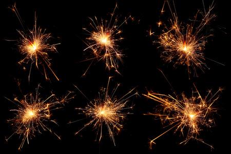黒い背景にクリスマス線香花火のセット 写真素材